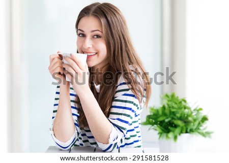 Woman with a cup of coffee  - stock photo