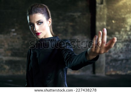 Woman with a dangerous look - stock photo