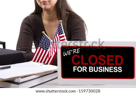 woman with a desk sign showing closed for business - stock photo