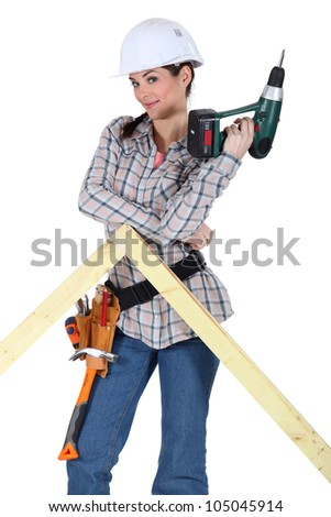 Woman with a drill and a frame - stock photo