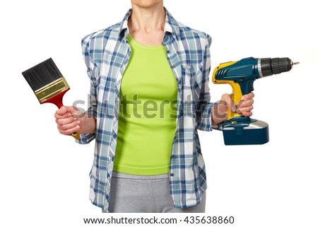 Woman with a drill. House renovation and repair concept. - stock photo