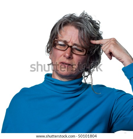 Woman with a headache puts her finger where it hurts - stock photo
