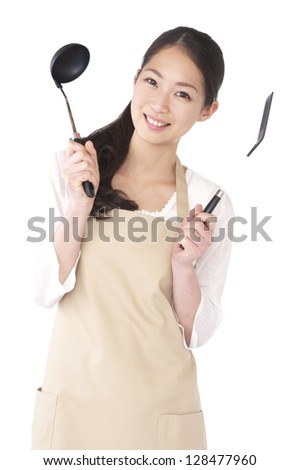 Woman with a ladle and spatula