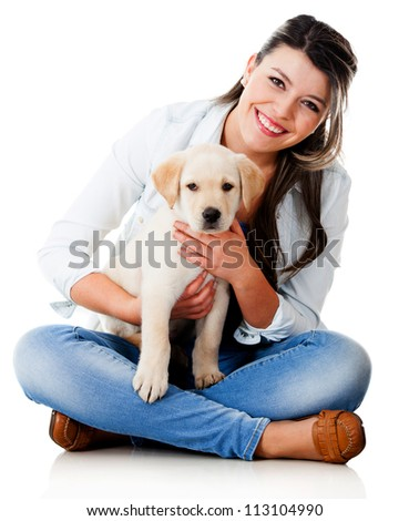 Woman with a little puppy - isolated over a white background - stock photo