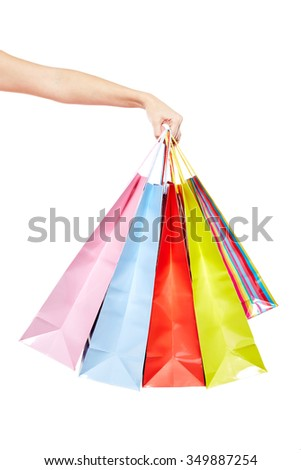 Woman with a lot of shopping bags - stock photo