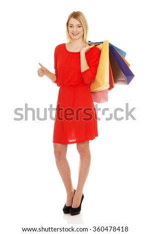 Woman with a lot of shopping bags.