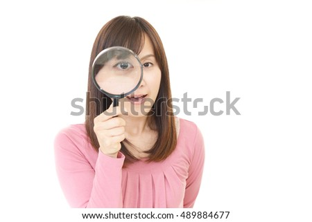 Woman with a magnifying glass