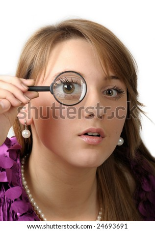 Woman with a magnifying glass on white background