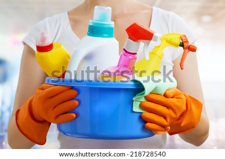 Woman with a pack of detergents