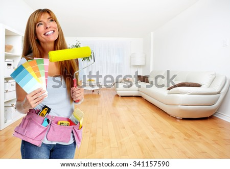 Woman with a painting roller. Home and house renovation. - stock photo