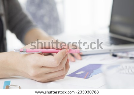 Woman with a pen - stock photo