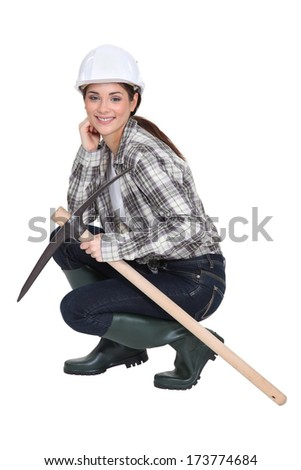 Woman with a pickaxe - stock photo
