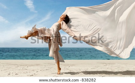 Woman with a pink scarf on the beach