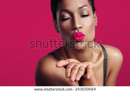 woman with  a pink velvet lips sending a kiss - stock photo