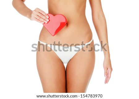 Woman with a red heart, white background.  - stock photo