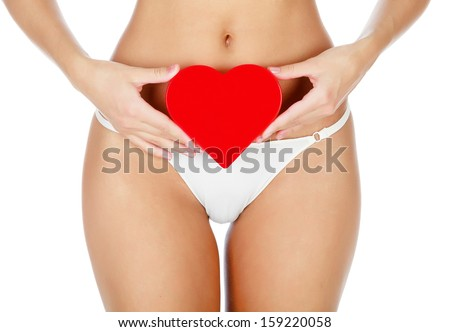 Woman with a red heart, white background  - stock photo