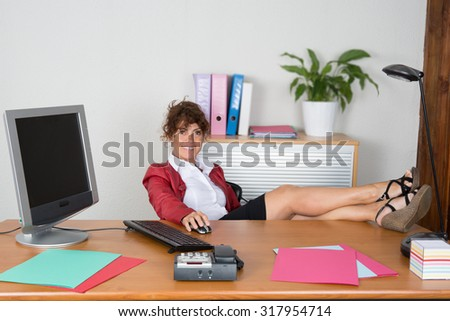 Woman with a red leather jacket at office