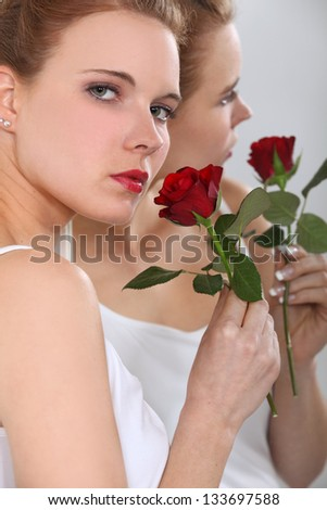 Woman with a red rose - stock photo