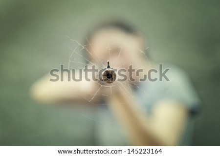 Woman with a rifle. Selective focus on the barrel. - stock photo