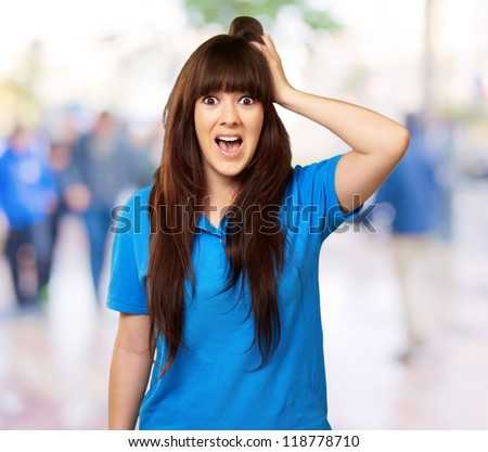 woman with a shocked expression, outdoor - stock photo