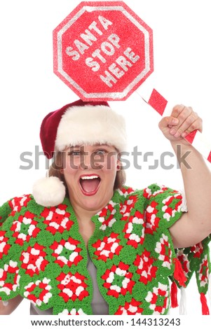 Woman with a sign that reads Santa Stop Here