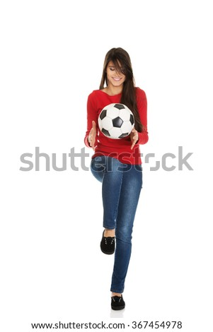 Woman with a soccer ball. - stock photo