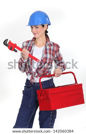Woman with a toolbox and wrench - stock photo