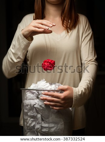 Woman with a trash can in his hands. The crisis of ideas. concept - stock photo