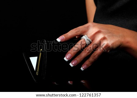 Woman with a wallet isolated on black background