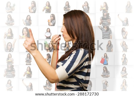 Woman with a whistle pointing with her finger - stock photo