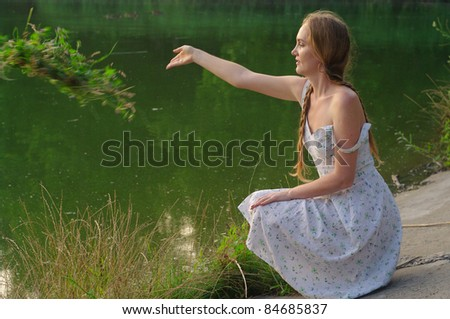 woman with a wreath on the nature - stock photo