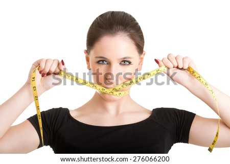 Woman with a yellow measuring tape around her mouth, isolated in white - stock photo