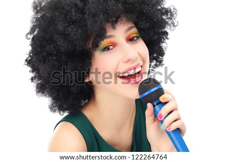 Woman with afro holding microphone - stock photo