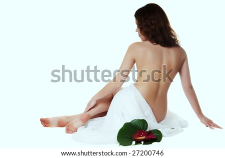 woman with an easy transparent fabric sits a back - stock photo