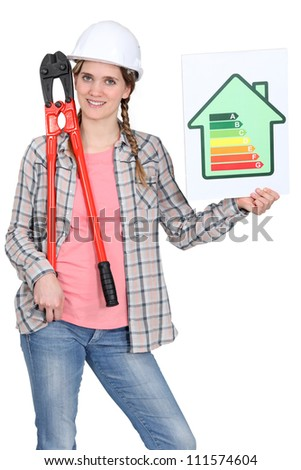 Woman with an energy rating sign - stock photo