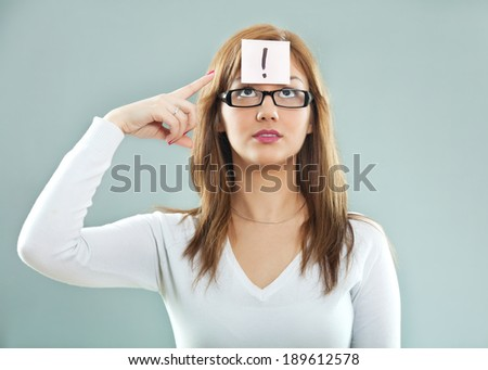 Woman with an exclamation point - stock photo
