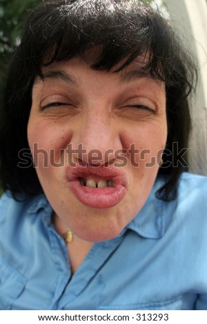 Woman with an ugly face - stock photo