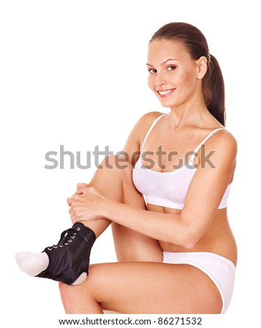 Woman with ankle brace. Isolated. - stock photo