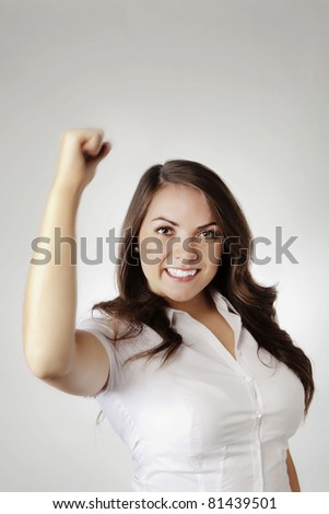 woman with arm high in the air - stock photo
