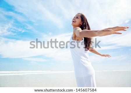 Woman with arms out carefree healthy summer lifestyle on holiday - stock photo