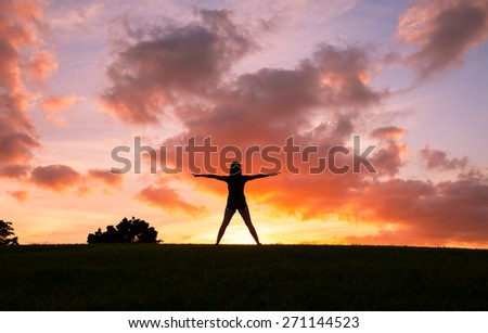 Woman with arms outstretched enjoying the great outdoors.