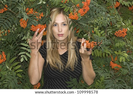 Woman with ashberry - stock photo