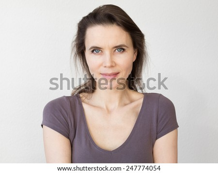 Woman with attractive smile looking into camera - stock photo