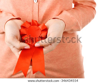 Woman with award ribbon, close-up, isolated on white - stock photo