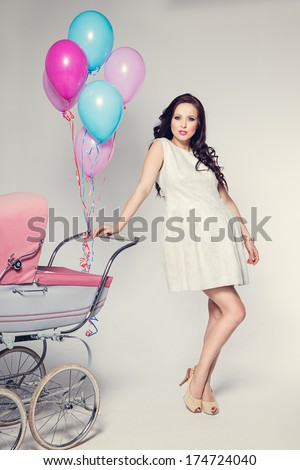 woman with baby stroller - stock photo