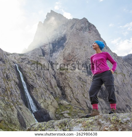 Woman with backpack is hiking in Caucasus mountains in Georgia - stock photo
