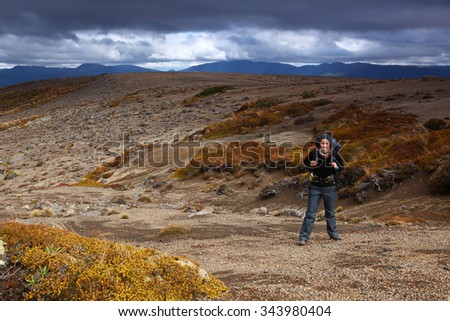 woman with backpack on hiking trail - Tongariro alpine crossing hiking trail, New Zealand