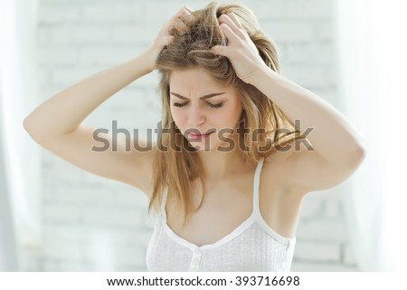 Woman with bad hair - stock photo