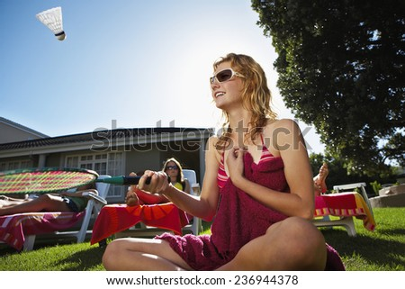 Woman With Badminton Racquet - stock photo