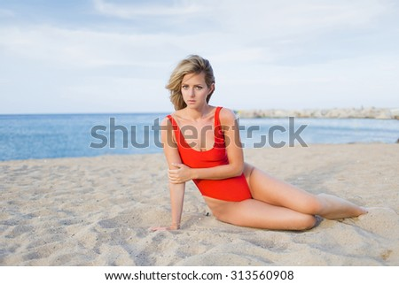 Woman with beautiful figure dressed in bikini posing for the camera against blue sea and sky background with copy space area for your text message or content, sexy female in swimsuit enjoying vacation - stock photo